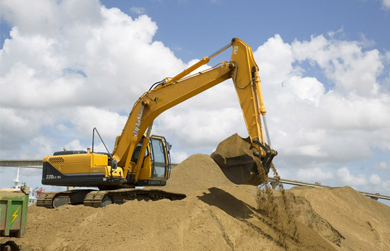 Excavator performing groundworks