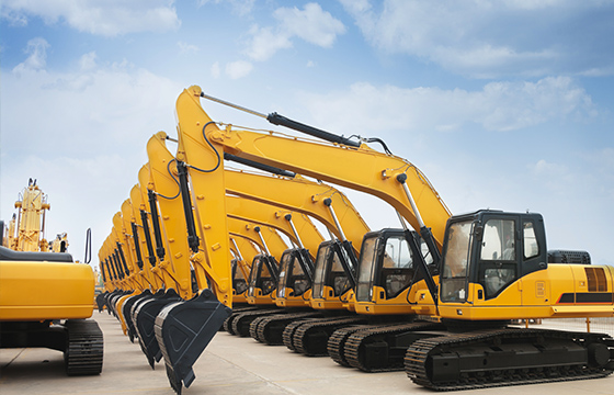 Excavators lined up in yard